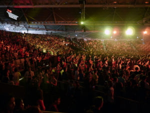 Megachurches, such as City Harvest Church in Singapore, have redefined worship and what a church experience looks like. Creative commons image by Adrian Hermann
