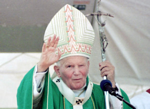 Pope John Paul II waves to the crowd fathered at Rio de Janeiro's Flamengo Embankment for the Conclusion of the Second World Meeting with Families in 1997.