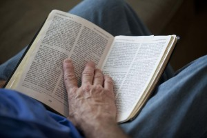 Bruce Boling holds a Bible open while participating in a Bible study group in Gallatin, Tenn. RNS photo by Jeff Adkins