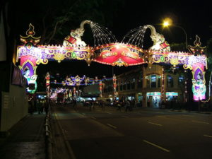 Singapore population includes a large South Indian origin population, who have celebrated Diwali and other Hindu festivals for over a century. Little India in Singapore decorated a week before Diwali. Creative commons image by Shankar S.