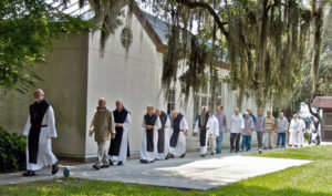 "The monks of Mepkin Abbey and a few monastic guests do a ""Cloister Walk,"" where the abbot leads the community from the noon service over to the refectory for lunch. RNS photo courtesy of William C. Carter III"