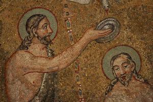 The baptism of Christ graces the ceiling of the Orthodox Baptistery in Ravenna, Italy. Creative commons image by Holly Hayes