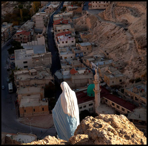 View of Ma'loula village in Syria with statue of the Virgin Mary and mosque. RNS photo by John Wreford, courtesy of Associated Reporters Abroad