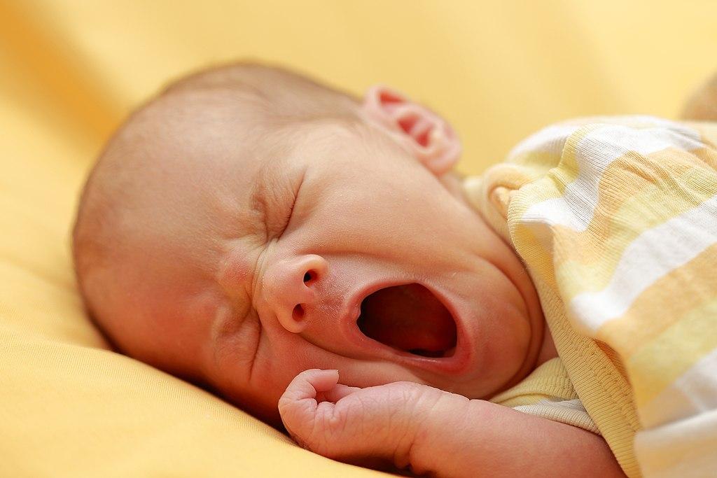 a newborn baby yawning